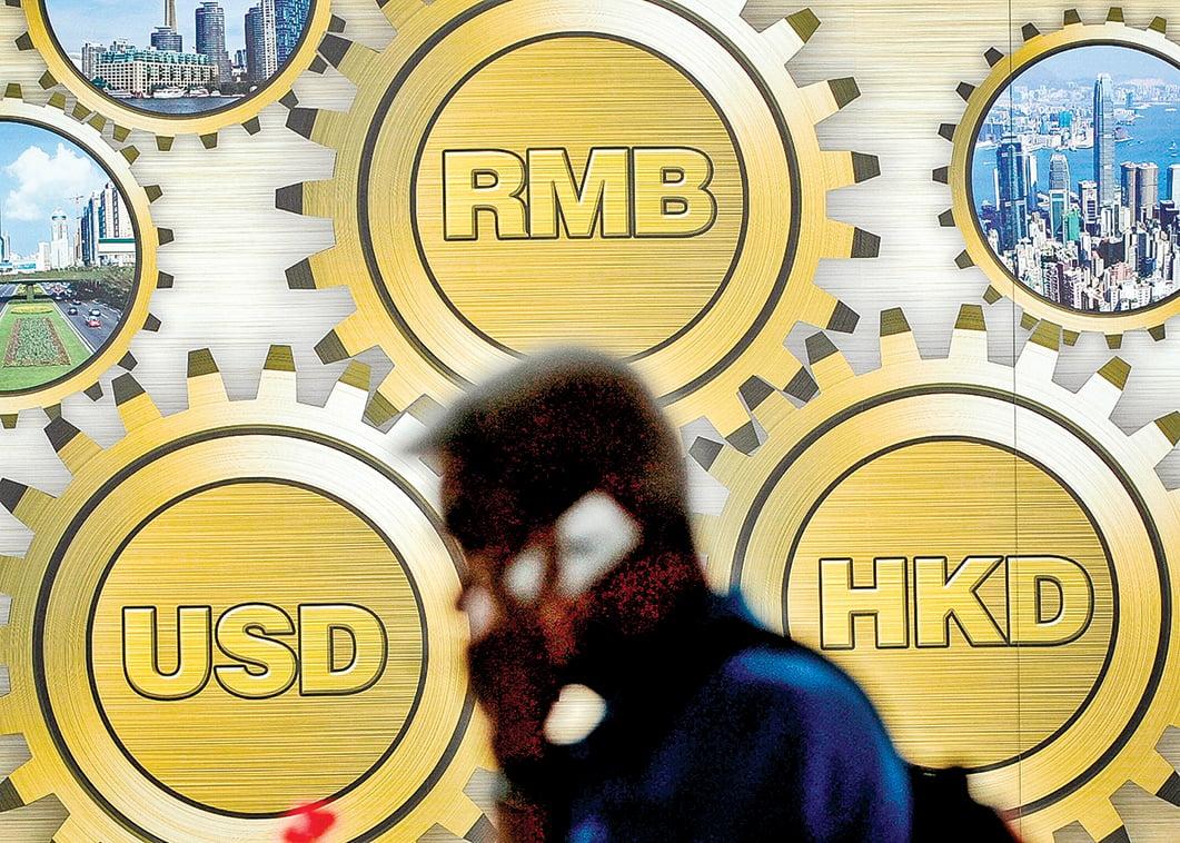 香港可以自由兌換美元,並且資金可以自由流動,是其成為金融中心的關鍵。如果美國做出限制措施,將嚴重影響香港的金融地位。(AFP)