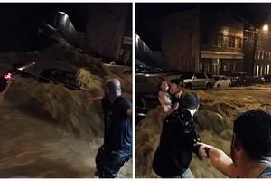 美東暴雨引發洪水 市民拉手救激流中婦女