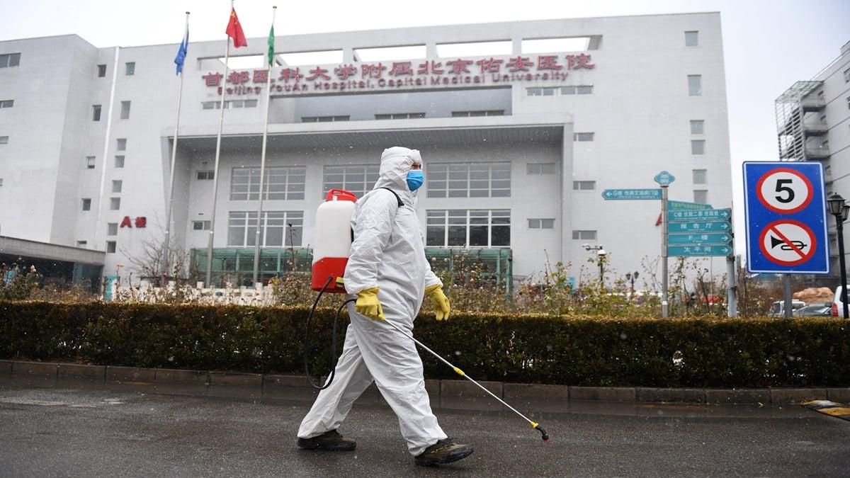 北京疫情又捲土重來。(GREG BAKER/AFP via Getty Images)