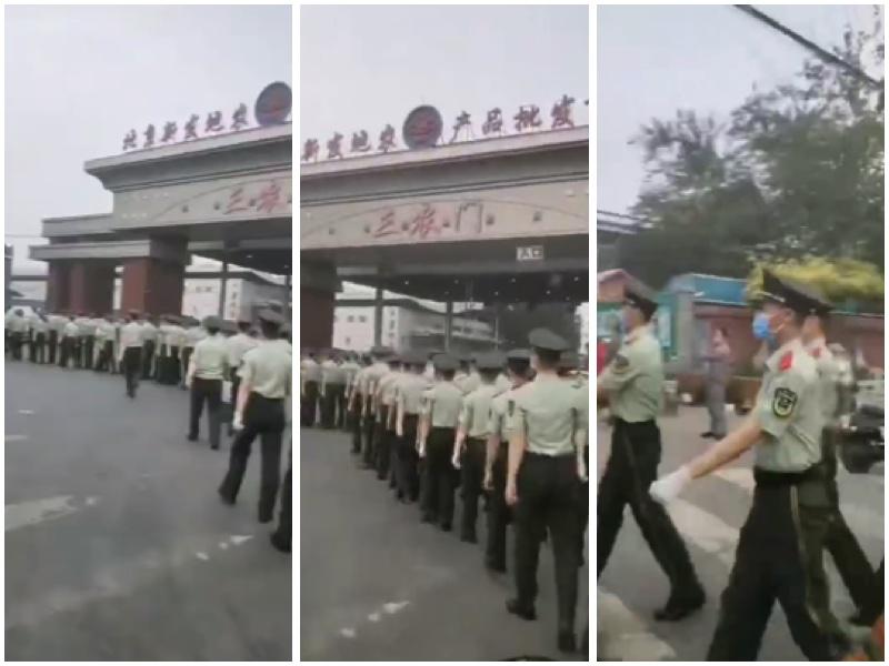 6月13日,新發地市場大批警衛人員進駐進行監控。(視頻截圖)