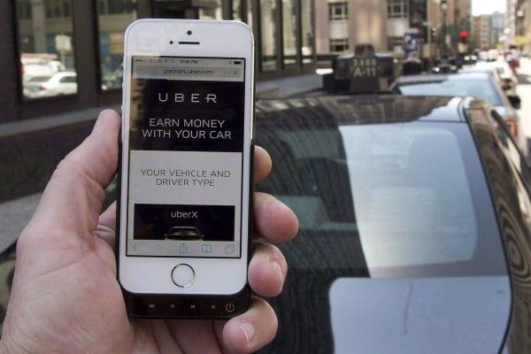 傳蘋果(Apple)在中國投資的叫車服務公司——滴滴出行(Didi Chuxing),以350億美元併購對手Uber。(Ryan Remiorz/加通社)