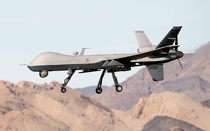 █ 美軍MQ-9無人機「死神」載有兩枚地獄火導彈。(Isaac Brekken/Getty Images)