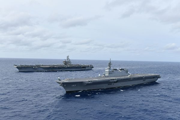 2019年6月11日,美軍航空母艦里根號(左)與日本海上自衛隊直升機護衛艦出雲號共同航行於南海。(U.S. Navy photo courtesy of JMSDF)