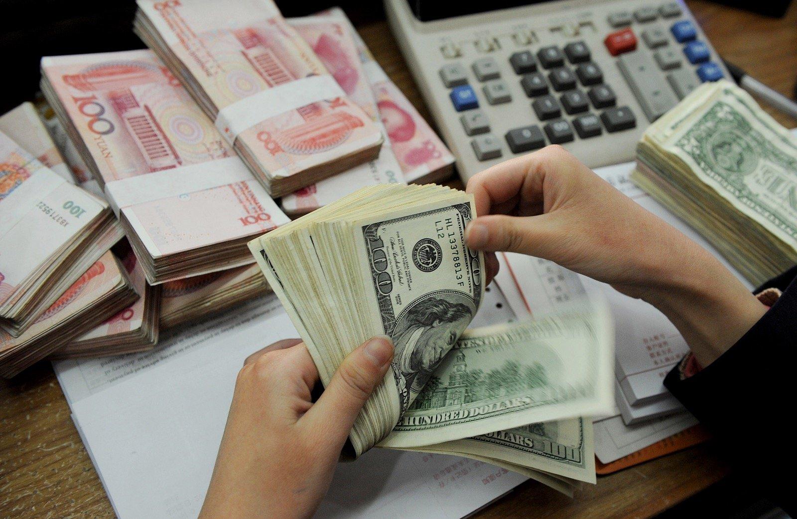 北京擔憂被禁用美元體系,加速推進人民幣國際化。(Getty Images)