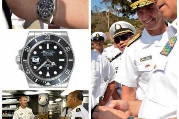 美國海軍作戰部部長喬納森・格林納特在太平洋艦隊聖迭戈基地邀請來訪的中共海軍司令吳勝利參觀美軍洛杉磯級核潛艇SSN-759傑斐遜城號。在報道中其中一張為喬納森・格林納特與吳勝利交談的照片近日卻引起鑒表專家們的興趣。(網絡圖片)