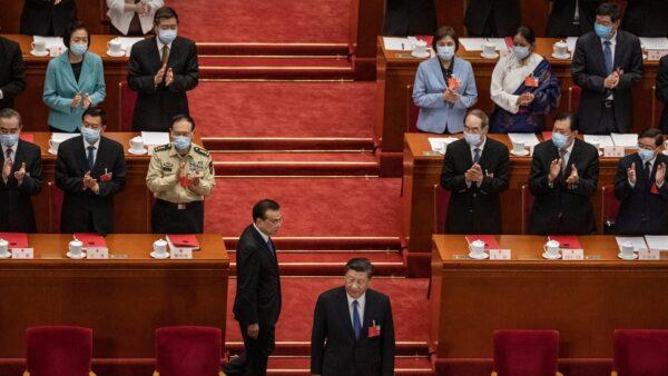 北京新一輪疫情大爆發,被指禍起5月底中共舉行的「兩會狂歡」,導致與會的中共官員中招。( Kevin Frayer/Getty Images)