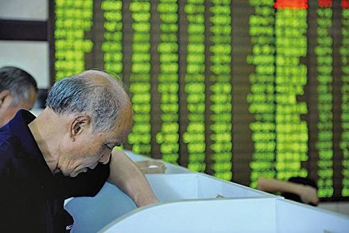 近來,A股多隻個股股價一度暴漲,期間微信群等有人推薦股票成交後股價突然暴跌。(Getty Images)