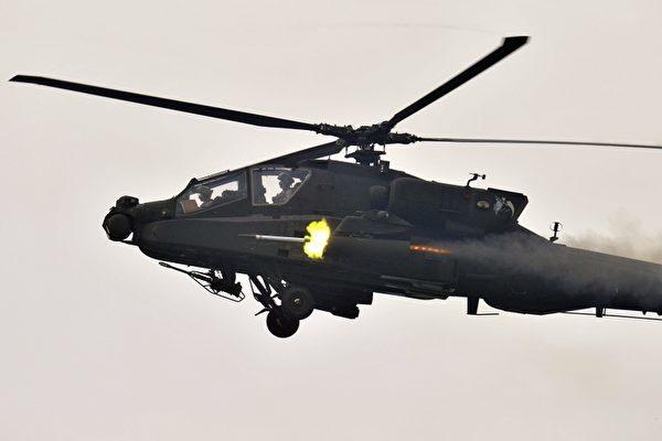 圖為阿帕奇武裝直升機。(JUNG YEON-JE/AFP)
