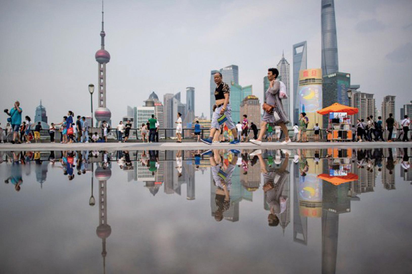 中國M1貨幣供應在迅速上升,但是M2貨幣供應卻沒有相應跟上。這導致中國式流動性陷阱的出現。 (JOHANNES EISELE/AFP/Getty Images)