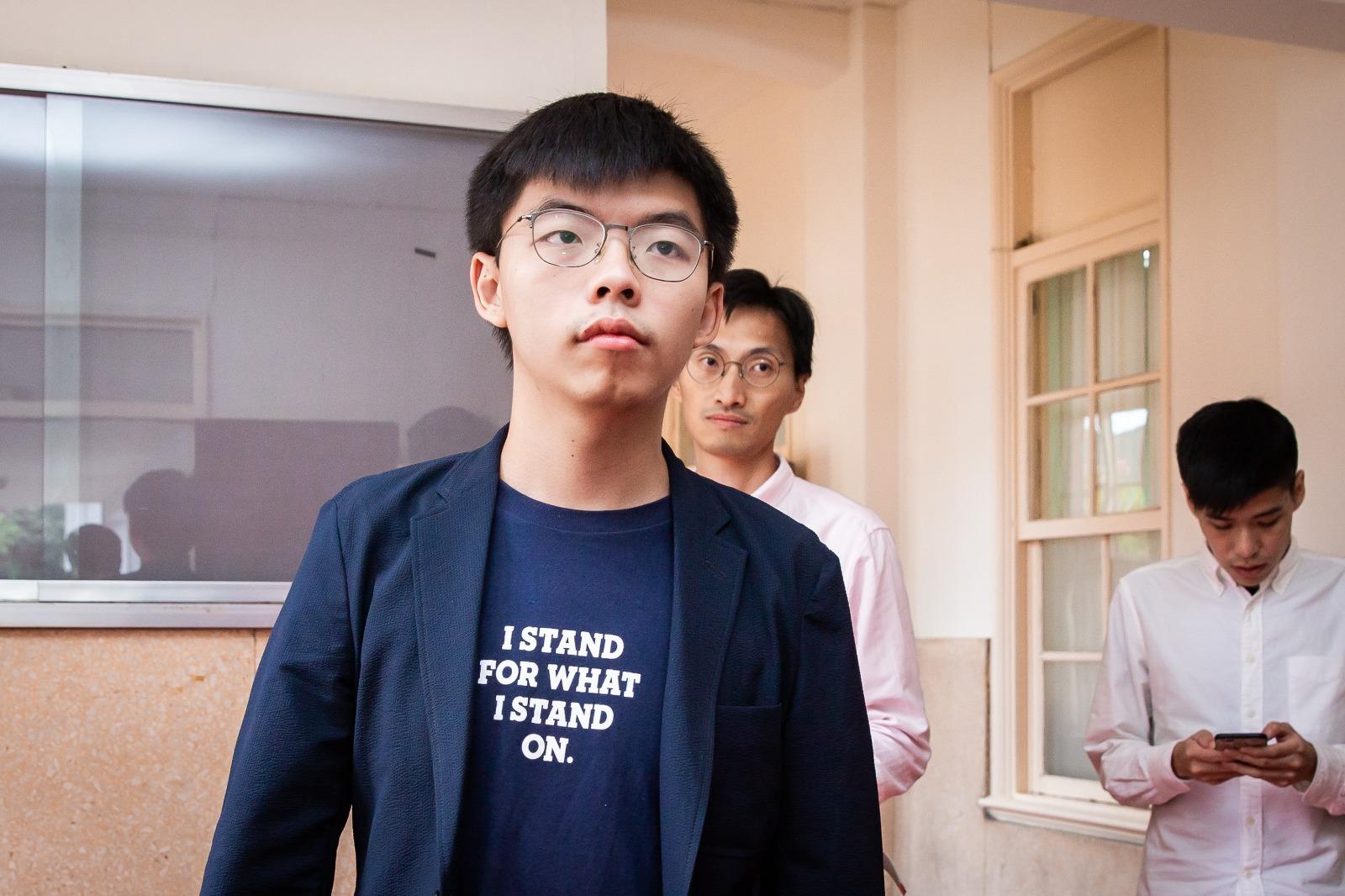 圖為前香港眾志秘書長黃之鋒(中)資料照。(陳柏州/大紀元)