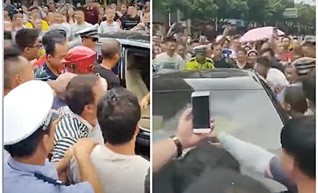 湖南省邵陽市禁電動車,引市民強烈不滿,示威人士堵住據稱是官員的車輛怒吼著掀車,人聲鼎沸。(影片截圖)