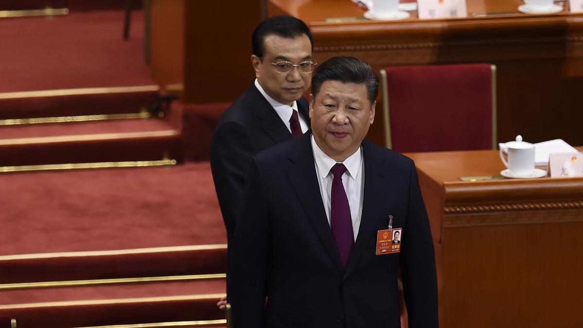 習李再次各說各話引發輿論關注。( WANG ZHAO/AFP/Getty Images)