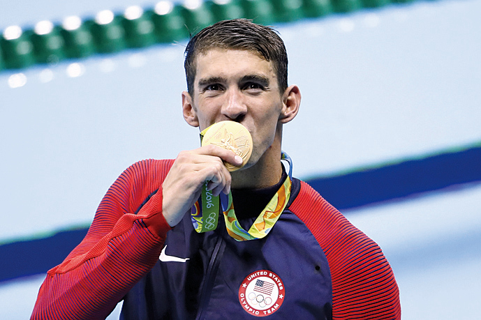 美國男泳將在綽號「飛魚」菲比斯(Michael Phelps)率領下,奪得了男子400米自由式接力賽金牌。(AFP)