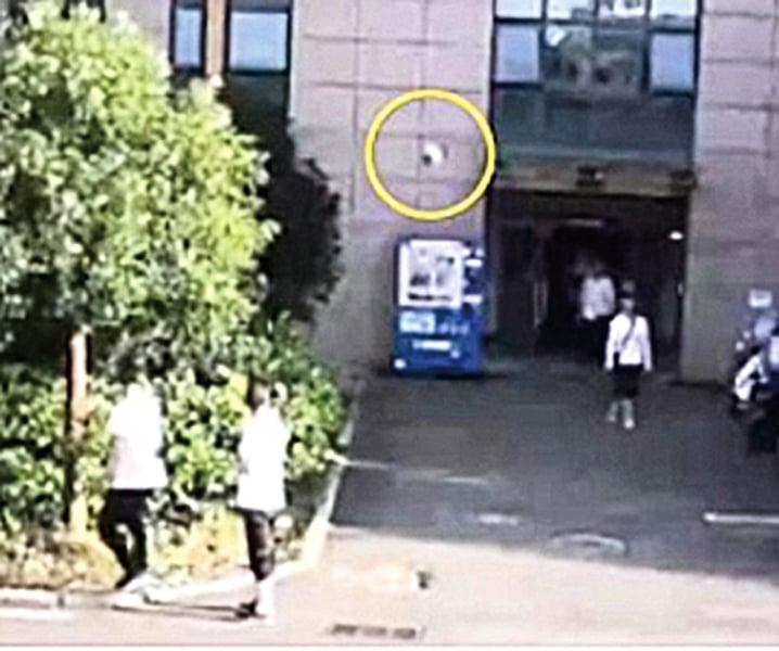 圖片新聞 PHOTO:合肥女生活不順13樓扔下電飯鍋