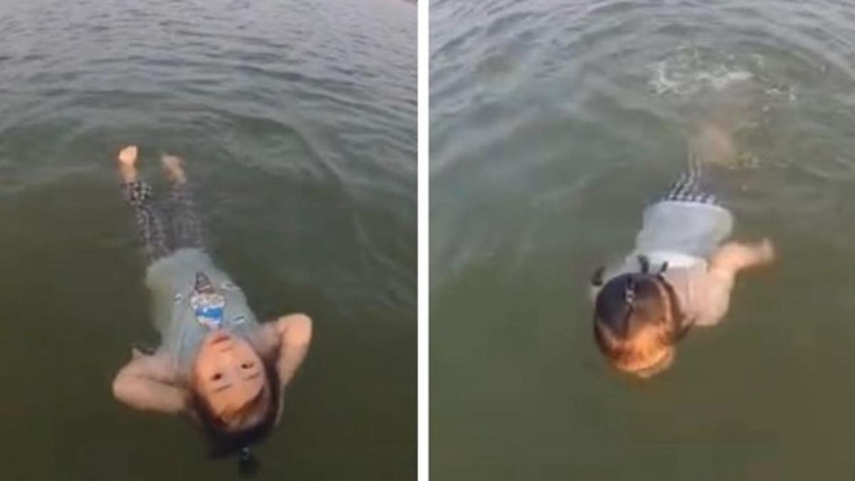 2歲女童「淼淼」10分多鐘橫渡了200米寬的沾天湖。(影片截圖)