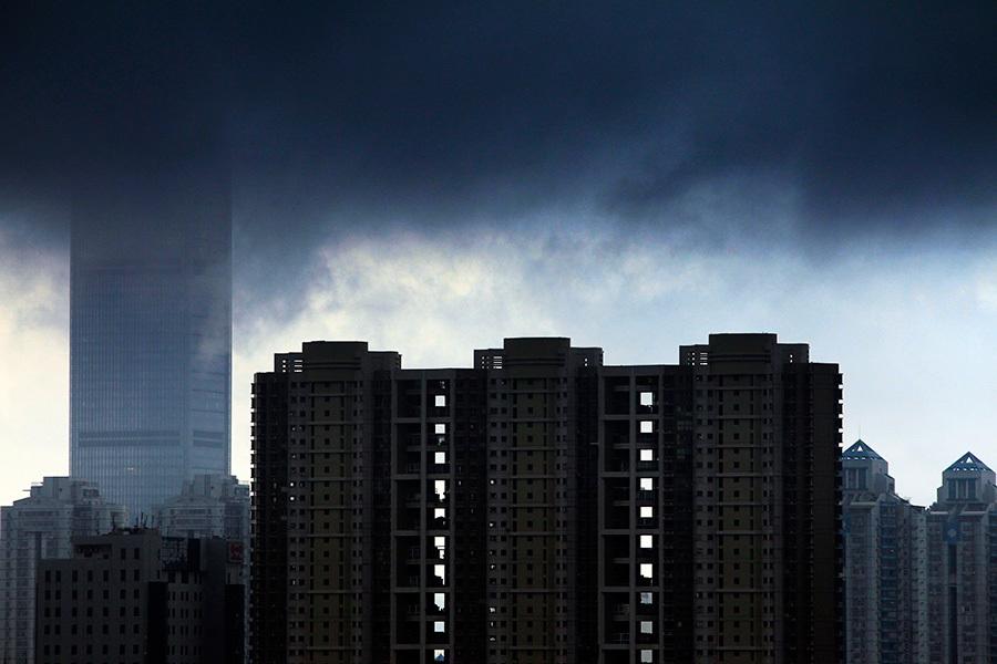 8月9日,中國樓市一天之內三大利空消息放出,有分析稱,中國樓市下半年或轉向。圖為興建中的樓市。(Getty Images)