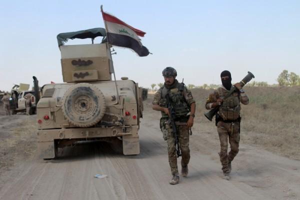 周三(8月10日)美軍打擊極端組織「伊斯蘭國」(IS)的最高指揮官表示,IS戰鬥力大大降低、全線撤退。圖為伊拉克軍隊。(MOADH AL-DULAIMI/AFP)