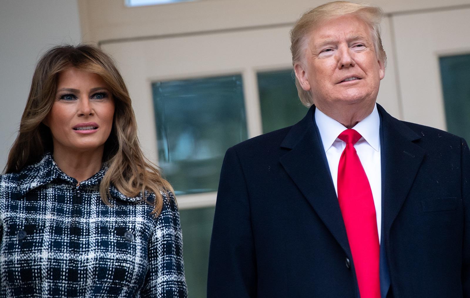 美國總統特朗普及夫人梅拉妮婭資料照。(SAUL LOEB / AFP)
