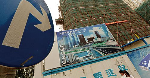 面對清冷的市場,鄭州房企掀起降價潮。圖為資料照。(AFP)
