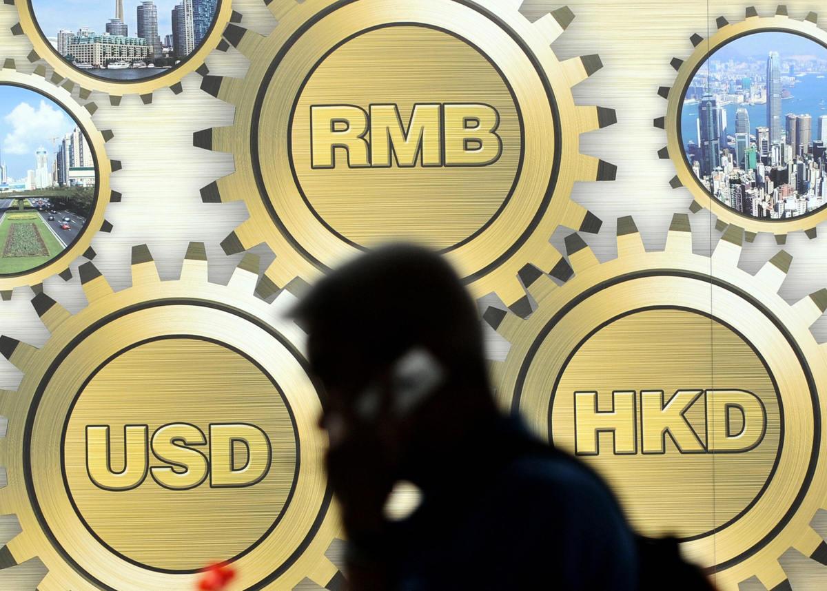 金發局指數字人民幣可在香港試行,中、美脫鉤下人民幣、港元一併消失?(Getty Images)