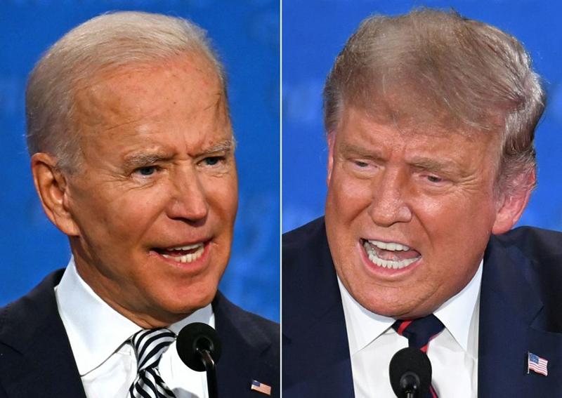 圖為9月30日,特朗普(右)與拜登(左)的第一場辯論。(JIM WATSON,SAUL LOEB/AFP via Getty Images)