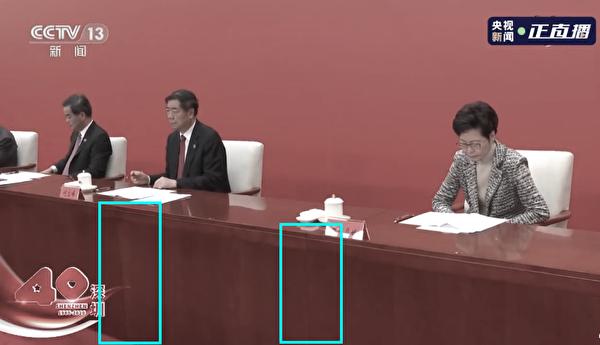 香港特首林鄭月娥與旁邊的中共國家發改委主任何立峰之間,被隔出一張桌子的距離。(影片截圖)