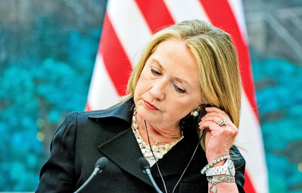 2012年9月5日,時任美國國務卿希拉里在北京人民大會堂與中方舉行聯合新聞發佈會。(AFP PHOTO / POOL / Jim WATSON)