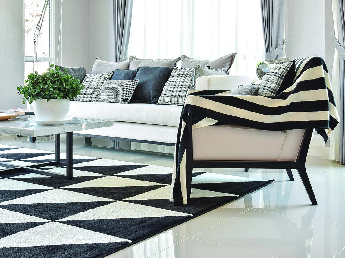 大膽的地毯圖案和顏色能提升整個房間的色調。