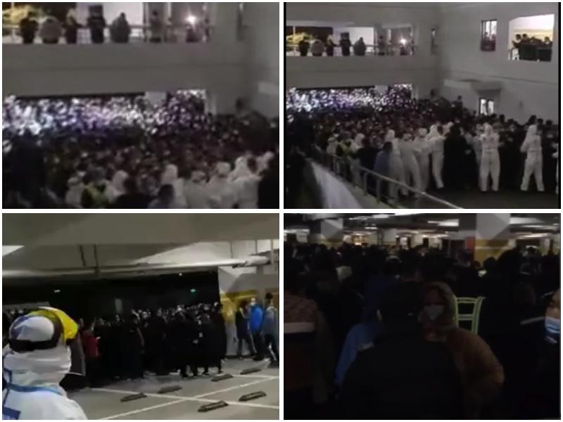 2020年11月22日,上海浦東國際機場停車場被用來集中核酸檢測,由於強行要求24時前結束,現場大排長龍,人潮擁擠。(影片截圖/大紀元合成)