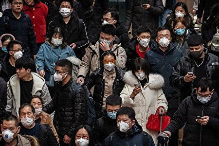 CNN披露一份中共內部117頁的機密文件顯示,武漢肺炎疫情爆發時,中共出於政治考量隱匿疫情的真實數據。(Kevin Frayer/Getty Images)