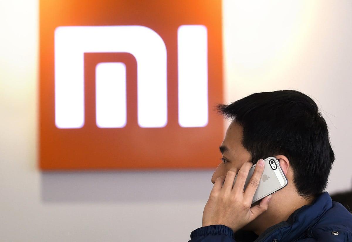 美國眾議院「外國公司問責法」法案表決前,小米集團12月2日宣布配股集資逾300億港元。(WANG ZHAO/AFP/Getty Images)