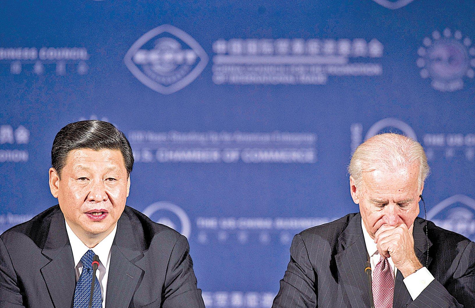 2012年2月14日,時任中共國家副主席習近平與美國副總統拜登進行會談。(JIM WATSON/AFP via Getty Images)