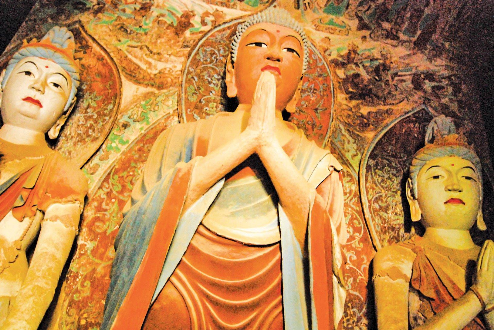 中國甘肅省敦煌市莫高窟千佛洞佛像。(Shutterstock)