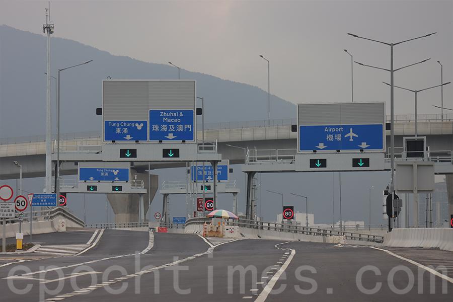 運輸署預計,屯赤隧道繁忙時段每小時可供2,200架次的小汽車單位使用,開通後有助於分流往來新界西北與大嶼山的交通。(陳仲明/大紀元)