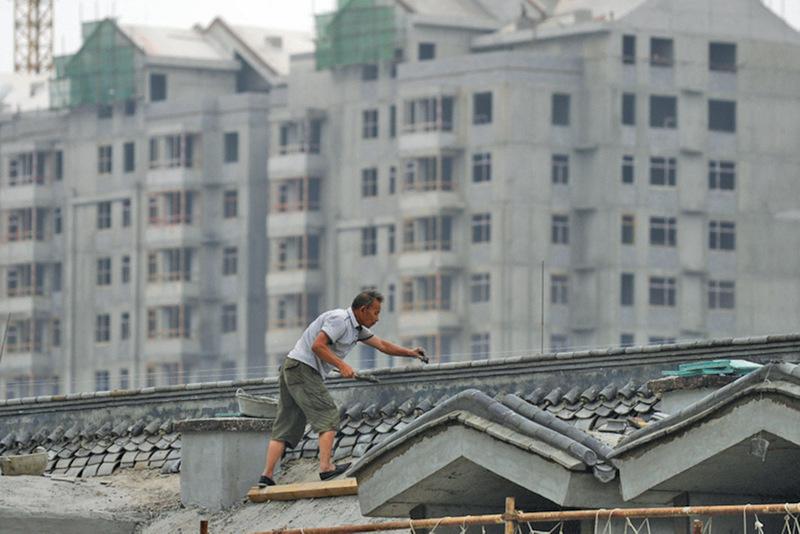 中共稱2015年全年GDP 同比增長6.9%,海外媒體和經濟學家認為,實際增長率更低。(WANG ZHAO/AFP)