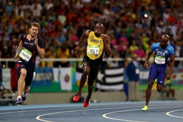 牙買加短跑名將保特(Usain Bolt)完成史無前例的100公尺、200公尺、400公尺接力3項3連霸。(Elsa/Getty Images)