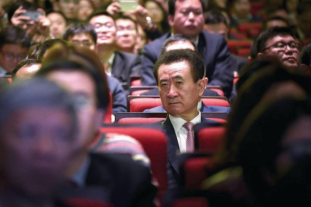 萬達集團董事長王健林(中)。(AFP)