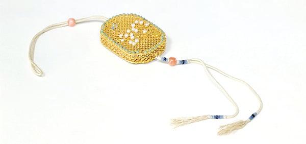 清‧金累絲鑲珠石香囊。(公有領域)