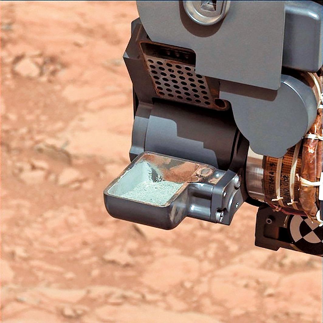 美國太空總署(NASA)的好奇號火星探測車首度成功從一塊火星岩取得樣品。(NASA 提供)
