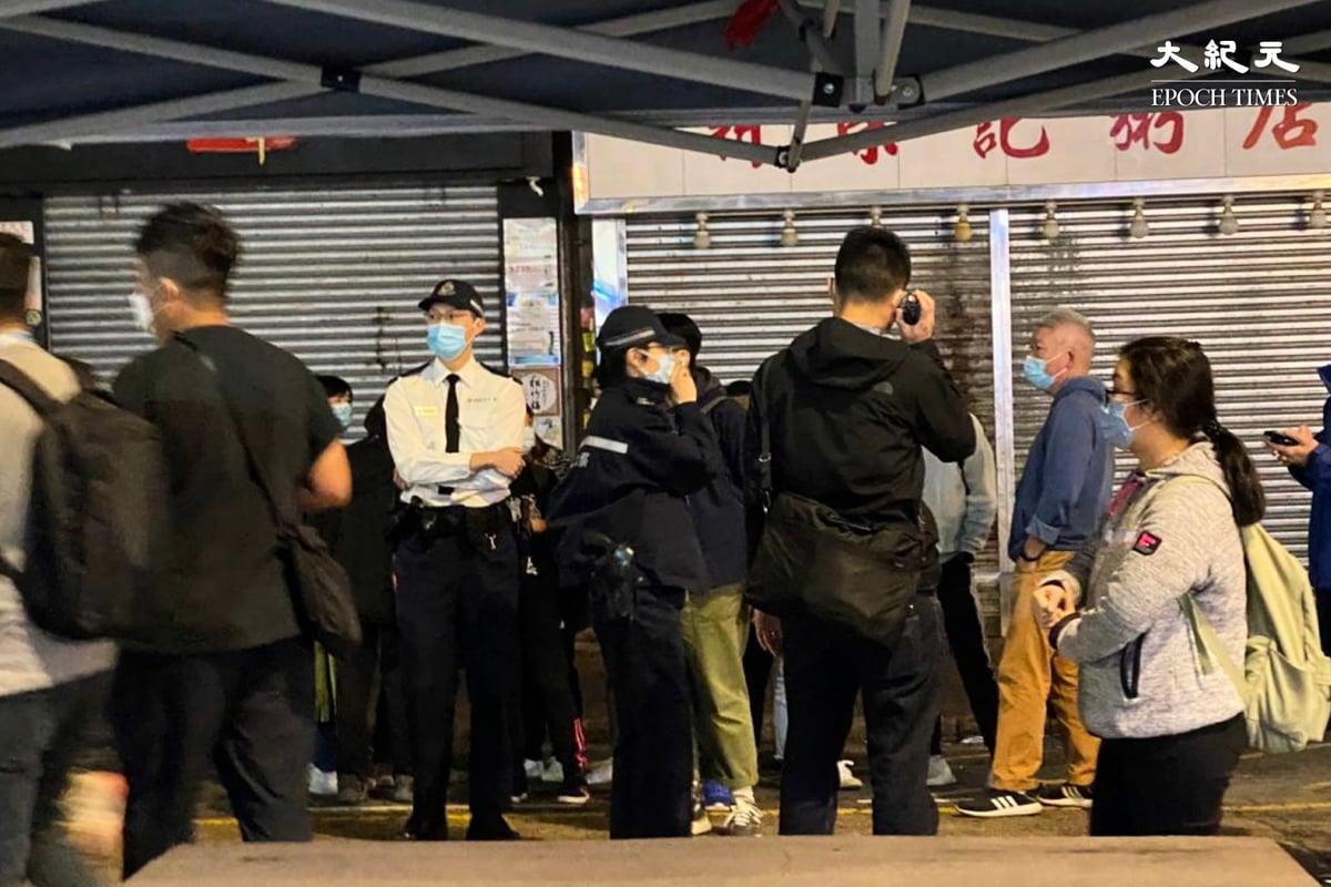 今(8日)晚上約8時20分,香港深水埗桂林街恒安樓一帶拉起封鎖線被列「受限區域」。(梁珍/大紀元)