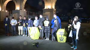 台灣多個人權團體8日於台灣中正紀念堂自由廣場舉行集會,為中共非法關押的人權捍衛者聲援、祈福,呼籲中共立即釋放這些人。(NTDTV影片截圖)