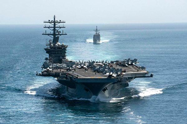 2021年2月9日,羅斯福號和尼米茲號兩個航母戰鬥群在南海進行聯合演習。圖為美軍航母尼米茲號(CVN68)。(elliot Schaudt/US NAVY/AFP)