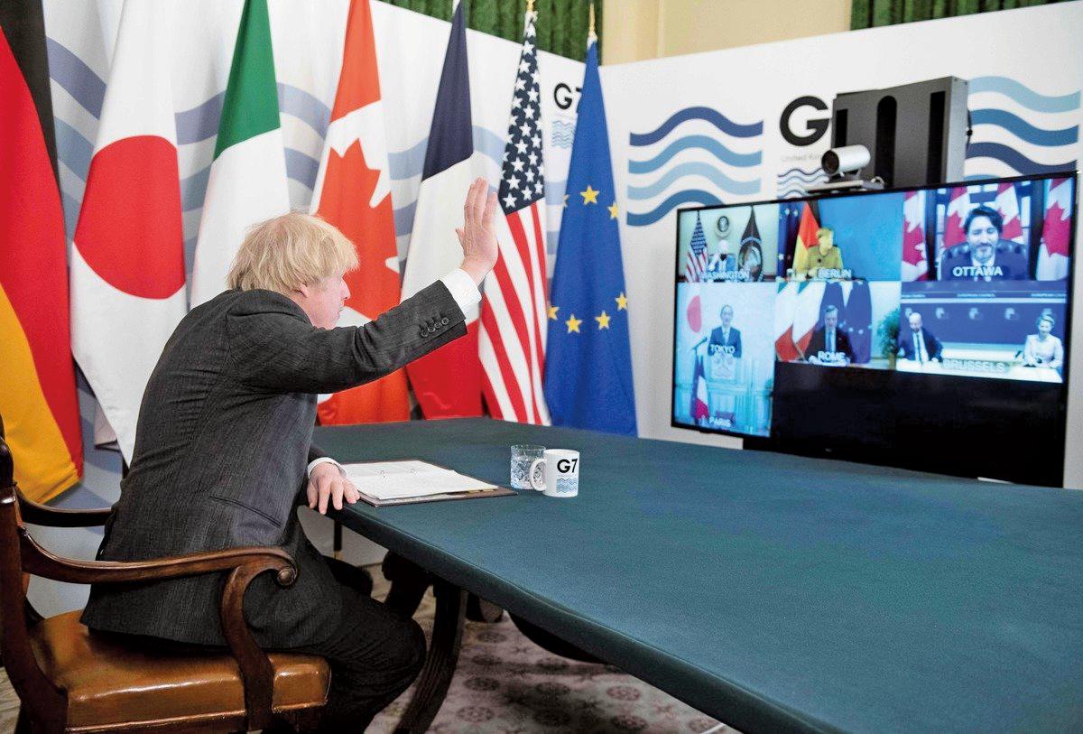 2021年2月19日,英國首相鮑里斯•約翰遜(Boris Johnson)在倫敦唐寧街的內閣會議室舉行G7領導人虛擬會議。(GEOFF PUGH/POOL/AFP via Getty Images)