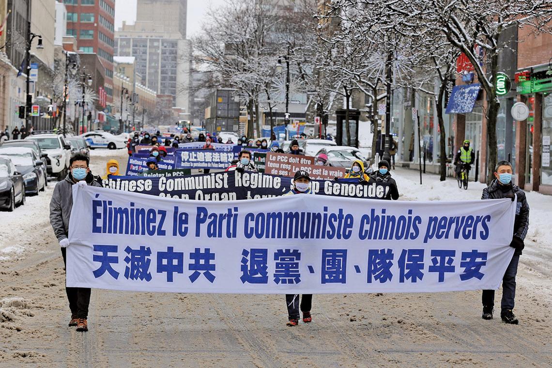 2021年2月27日下午,加拿大魁北克省部份法輪功學員在滿地可舉行「天滅中共 結束迫害」大遊行。(大紀元)