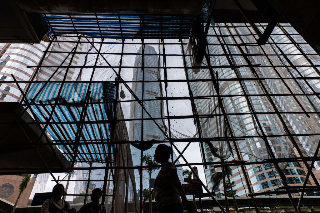 IHS Markit今(3月3日)公佈2月份香港服務業PMI為50.2,反映私營企業商務活動在緩慢擴張。(ANTHONY WALLACE/AFP via Getty Images)