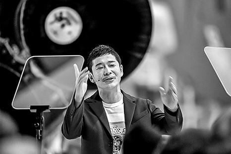 圖為日本富豪前澤友作。(AFP)