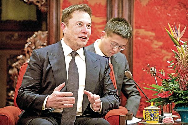馬斯克2019年1月進入中南海受到中共總理李克強高調接見,當時中美貿易大戰正酣。(AFP)