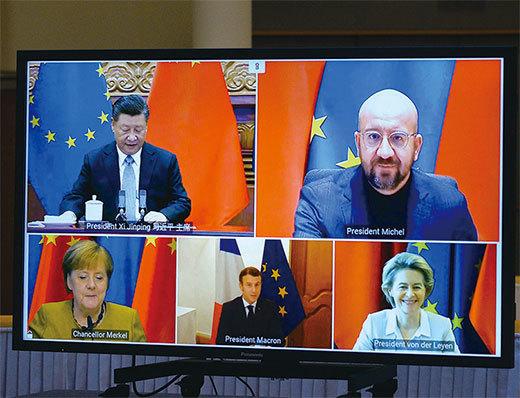 2020年12月30日歐盟和中國達成商業投資協議。圖為習近平與歐盟領導人舉行視訊會談。(Johanna Geron/AFP)