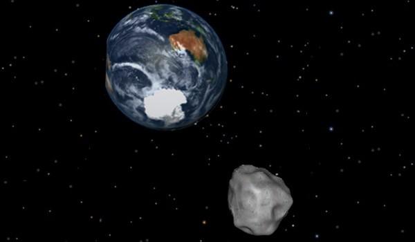 示意圖:小行星穿過地球。(NASA/JPL-Caltech)