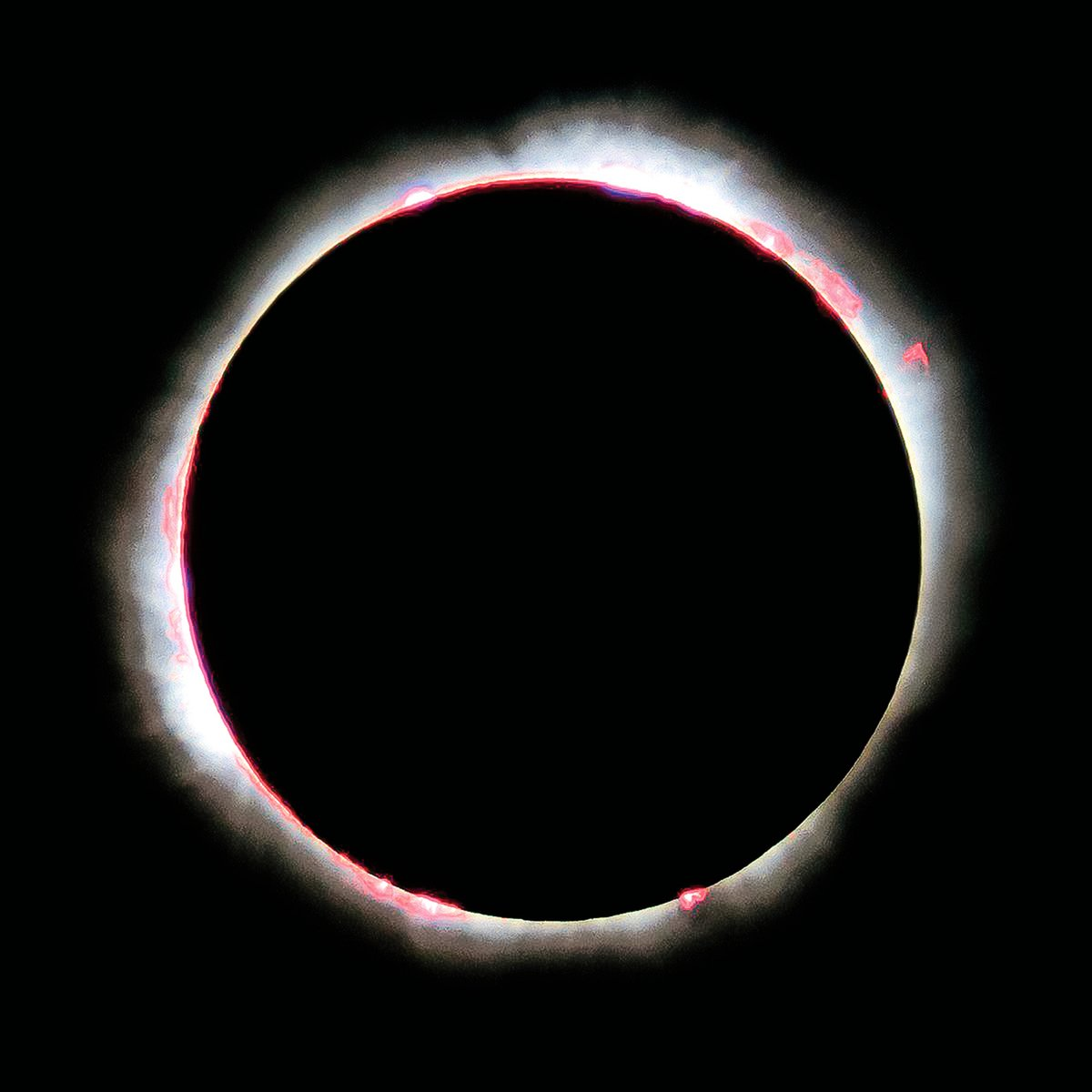 日全食過程中拍到的太陽色球層。由於氫原子發出的紅色和粉色的光因而被稱為色球層。(NASA/ Luc Viatour)